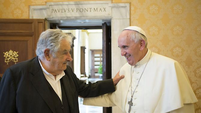 Pope Francis talks with Uruguay's former President Mujica during a private meeting at the Vatican