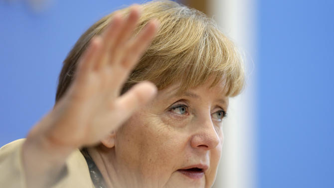 German Chancellor Angela Merkel gestures during a press conference in Berlin, Germany, Monday, Sept. 17, 2012. (AP Photo/Markus Schreiber)