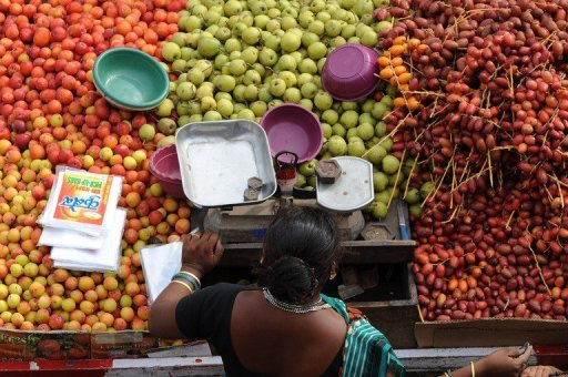 <p>A fruit vendor waits for customers at a market in Ahmedabad. Indian inflation accelerated to its highest level this year, hitting 7.81% in September, data showed on Monday, outpacing market forecasts and reducing the chances of a rate cut.</p>