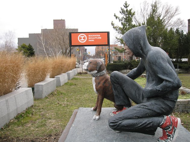 "This March 6, 2013 photo shows ""Raymond & Toby,"" a 1994 sculpture by John Ahearn at Socrates Sculpture Park in the Astoria section of the Queens borough of New York.  The waterfront park is one of sev"