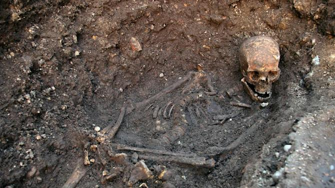 This undated photo provided by the University of Leicester shows the remains of England's King Richard III which were found in a dig in Leicester, England in September 2012. Not only was Richard III one of England's most reviled monarchs, but it now turns out the hunchback king was probably infected with parasitic worms that grew up to a foot in length. Researchers who dug up Richard III's skeleton underneath a parking lot report they have found roundworm eggs in the soil around his pelvis, where his intestines would have been. They compared that to soil samples taken close to Richard's skull and surrounding his grave, where there weren't any eggs. In a study published online Wednesday Sept. 4, 2013 in the journal Lancet, experts say it's unlikely the worms did any serious damage to the king. (AP Photo/University of Leicester)