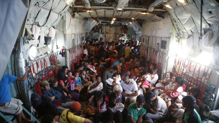 Typhoon survivors are pictured in the hold of a C-130 military transport plane at Tacloban airport in central Philippines