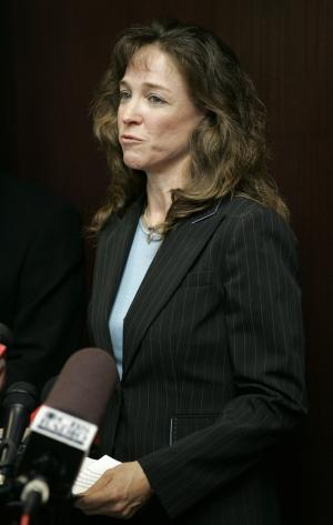 "FILE - In this Aug. 24, 2007 file photo, Lisa Nowak makes a brief statement to the media outside the courtroom after a hearing at the Orange County courthouse in Orlando, Fla. Nowak, banished from NASA after she attacked a romantic rival, will retire from the Navy with an ""other than honorable"" discharge and her pay grade will be knocked down one rank, Assistant Secretary of Navy Juan Garcia said in a statement Thursday, July 28, 2011. (AP Photo/John Raoux, File)"