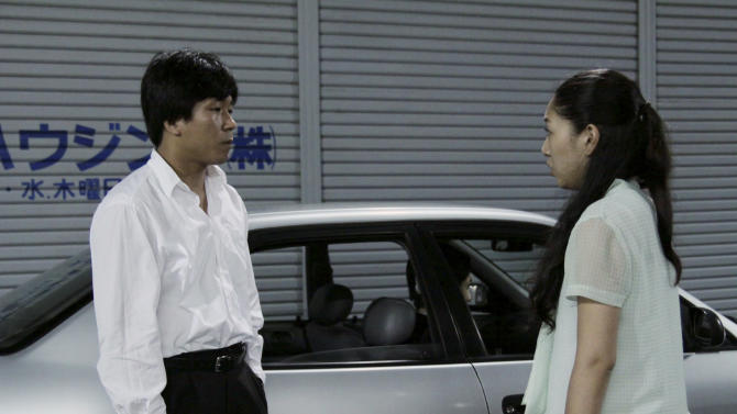 """In this undated photo released on Saturday, Oct. 6 2012 by Busan International Film Festival, Japanese actress Sakura Ando and South Korean actor Yun Sung-ho act in a scene from the movie """"Our Homeland"""" in Japan. Korean-Japanese filmmaker Yang Yonghi says she leaned on her own personal history and similar stories from her pro-North Korean community in Japan for her latest movie, which made its South Korean debut Saturday, Oct. 6, 2012 at the Busan International Film Festival. (AP Photo/Busan International Film Festival) EDITORIAL USE ONLY"""