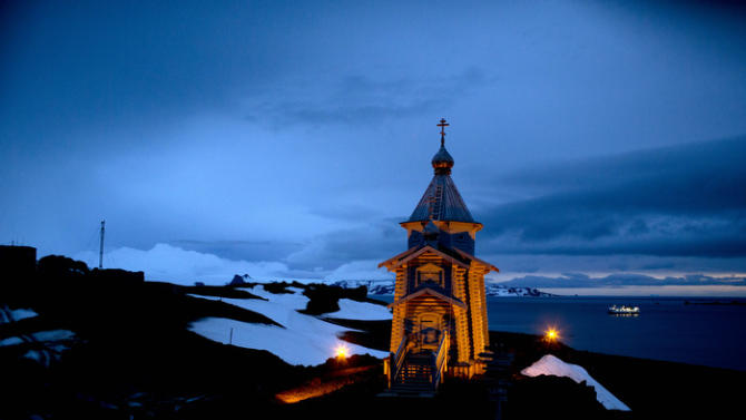 In this Feb. 1, 2015 photo, Holy Trinity church stands illuminated at Russia's Bellinghausen station on King George Island in Antarctica. Holy Trinity is the world's southernmost Eastern Orthodox Church as well as doubling as a beacon of light for incoming ships. (AP Photo/Natacha Pisarenko)