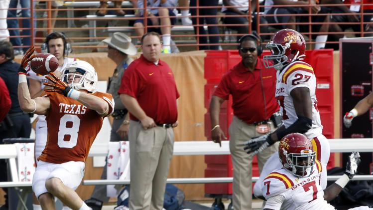 Texas receiver Jaxon Shipley (8) reaches for a tipped pass against Iowa State defensive back Cliff Stokes in the fourth quarter of an NCAA college football game at Darrell K Royal-Memorial Stadium, Saturday, Nov. 10, 2012, in Austin, Texas. Texas won 33-7. (AP Photo/Michael Thomas)