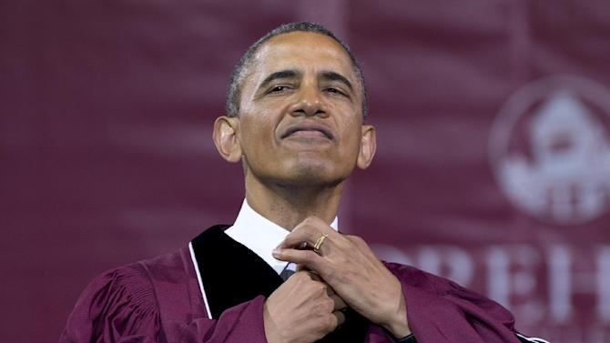 President Barack Obama straightens his tie before he receives an honorary doctorate of laws degree during the Morehouse College 129th Commencement ceremony, Sunday, May 19, 2013, in Atlanta. n a soaring commencement address on work, sacrifice and opportunity, the President told graduates of the historically black college to seize the power of their example as black men graduating from college and use it to improve people's lives.  (AP Photo/Carolyn Kaster)