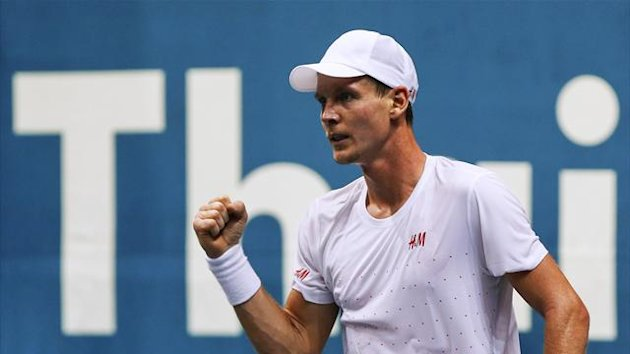 Tomas Berdych of the Czech Republic celebrates a point against Gilles Simon of France during their men's singles semi-finals match at the Thailand Open tennis tournament in Bangkok September 28, 2013 (Reuters)