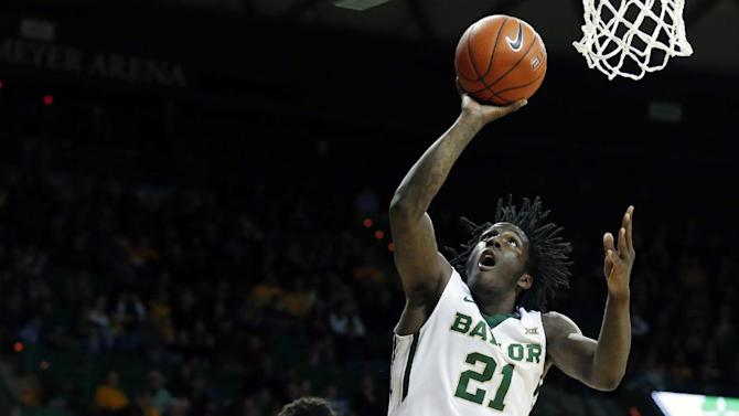 Baylor forward Taurean Prince (21) shoots past Texas Tech center Isaiah Manderson (1) in the first half of an NCAA college basketball game, Friday, March, 6, 2015, in Waco, Texas. (AP Photo/Jerry Larson)