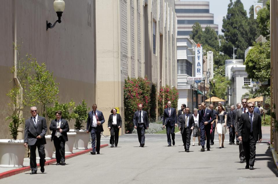 "Prince William and Kate, the Duke and Duchess of Cambridge, walk with Secret Service agents as they arrive at the Sony Pictures Studios in Culver City, Calif., Sunday, July 10, 2011, to attend the Mission Serve ""Hiring Our Heroes Los Angeles"" job fair for veterans and military spouses. (AP Photo/Jae C. Hong, Pool)"