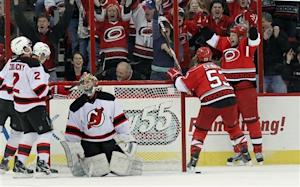 Tlusty scores 2 in Hurricanes' 6-3 win over Devils