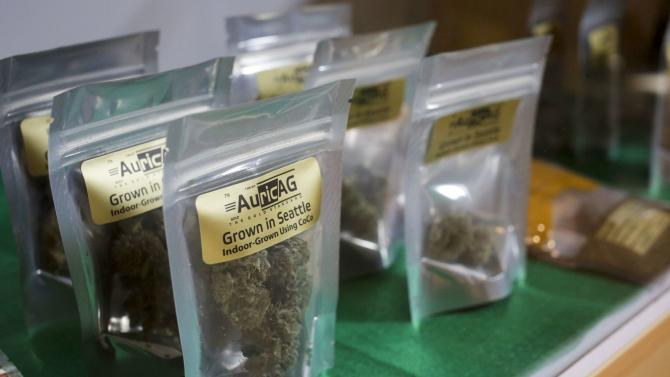 Seattle-grown marijuana are pictured in a display case at The Cannabis Corner in North Bonneville