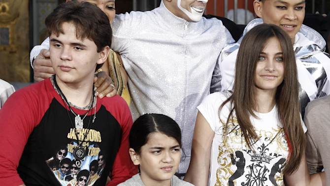 """FILE - This Jan. 26, 2012 file photo shows, from left, Prince Jackson, Blanket Jackson and Paris Jackson after a hand and footprint ceremony honoring their father musician Michael Jackson in front of Grauman's Chinese Theatre in Los Angeles. The executors of Michael Jackson's estate say they are concerned about the welfare of the singer's mother and his three children. In a letter posted on fan sites Tuesday, July 24, executors John Branca and John McClain says they are doing what they can to protect them from """"undue influences, bullying, greed, and other unfortunate circumstances."""" The letter came hours after sheriff's deputies responded for a family disturbance at the hilltop home where Katherine Jackson and her three grandchildren live. No arrests were made, but there is an active battery investigation. Katherine Jackson was reported missing over the weekend, but is with relatives in Arizona. (AP Photo/Matt Sayles)"""