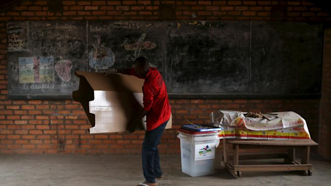 A man organises electoral material prior to the start of the second round of presidential and legislative elections in the mostly muslim PK5 neighbourhood of Bangui, Central African Republic