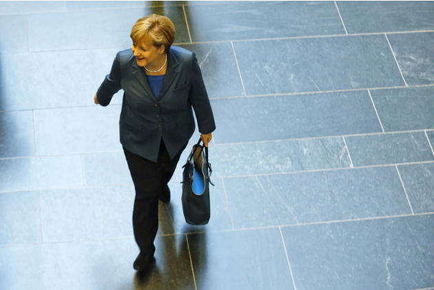 German Chancellor and chairwoman of the Christian Democrats (CDU) Angela Merkel arrives for a meeting with the Christian Democratic parties delegation prior to exploratory talks about an coalition wit