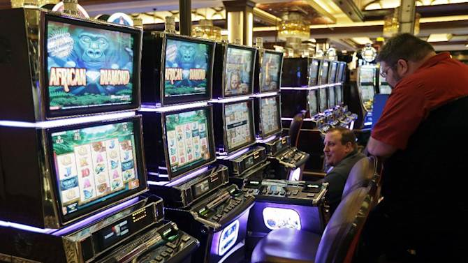 Workers checks slot machines inside Horseshoe Casino Cincinnati, Tuesday, Feb. 26, 2013, in Cincinnati. Denominations among more than 2,000 slots and video poker machines range from $.01 to $500 per spin at the casino is set to open to the public Monday, March 4. (AP Photo/Al Behrman)