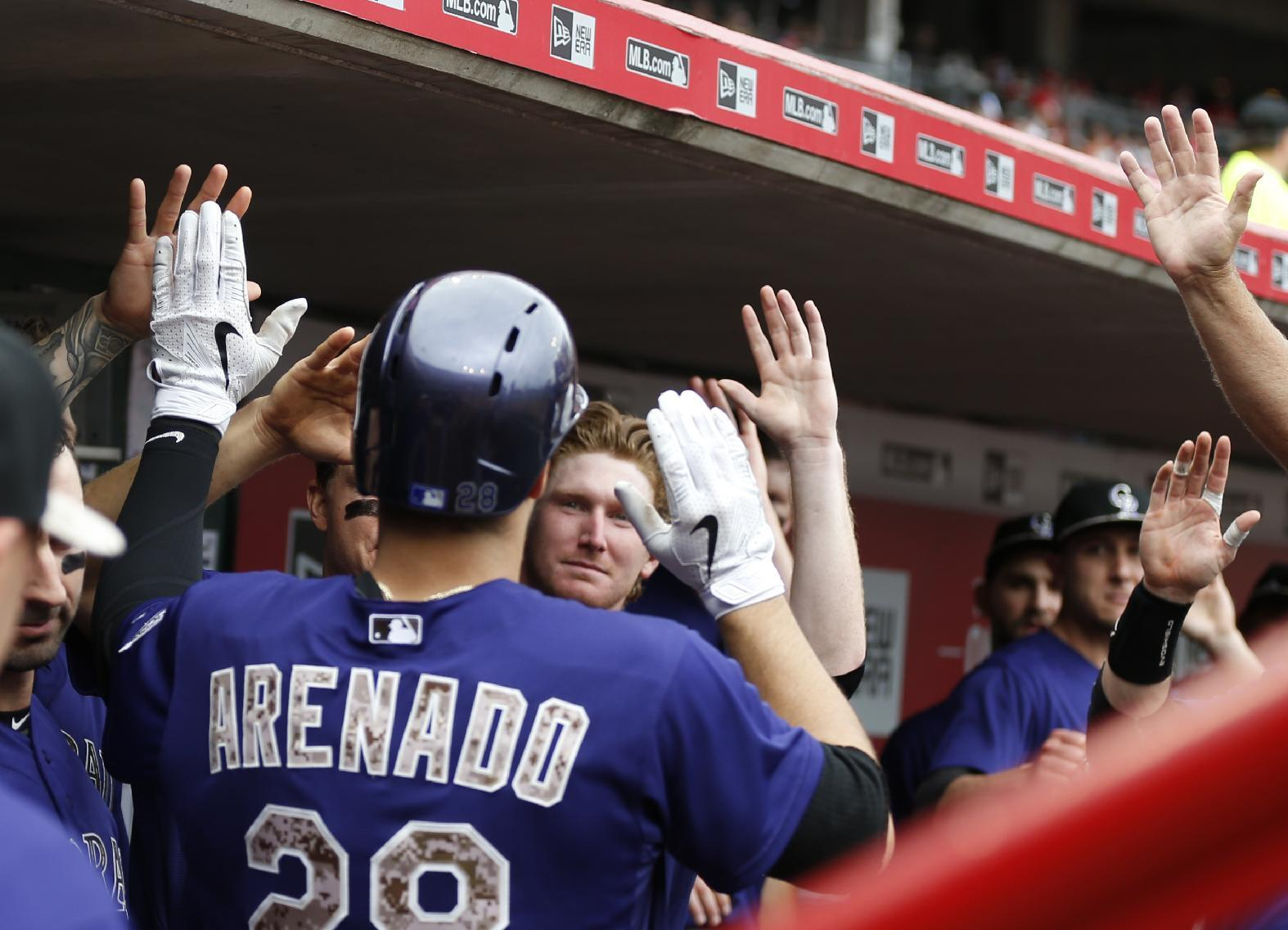 Reds lose 9th straight, Arenado leads Rockies to 5-4 win