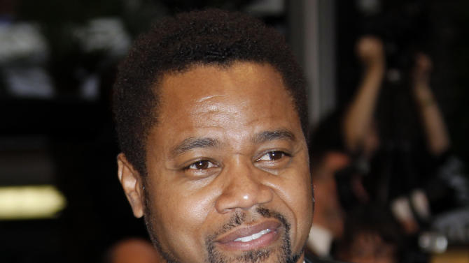 """FILE - This May 25, 2012 file photo shows actor Cuba Gooding Jr arriving for the screening of """"Cosmopolis"""" at the 65th international film festival, in Cannes, southern France. New Orleans police say an arrest warrant has been issued on a municipal battery charge for actor Cuba Gooding after an incident Tuesday, July 31, at a New Orleans bar. Gooding was in New Orleans filming. (AP Photo/Joel Ryan, file)"""