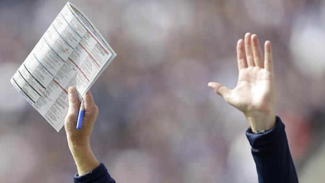 Dallas Cowboys head coach Jason Garrett reacts after officials confirmed running back Felix Jones's touchdown after a review in the first half of an NFL football game against the Baltimore Ravens in Baltimore, Sunday, Oct. 14, 2012. (AP Photo/Patrick Semansky)