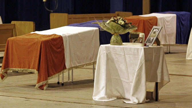 The coffins of French Air Force soldiers who died in the recent NATO F-16 crash at Los Llanos air force base in southern Spain on January 28, 2015, are displayed at the BA 133 air base in Nancy, eastern France, Thursday Jan. 29, 2015. Nine French and two Greek personnel died and about 20 people were injured after the two-seater F-16, owned by Greece, crashed into parked aircraft at the Los Llanos base in southeastern Spain. (AP Photo/Mathieu Cugnot)