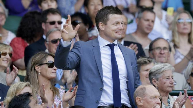 Former rugby player Brian O'Driscoll waves to spectators on Centre Court as he is introduced at the Wimbledon Tennis Championships in London
