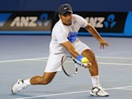 Leander Paes hits a volley during the men&#39;s doubles final at the 2012 Australian Open in Melbourne, Australia, on January 28. Paes - India&#39;s top tennis doubles player - will team up with a poorly-rated and inexperienced partner at the Olympics after two higher-ranked players refused to play with him, officials said Thursday