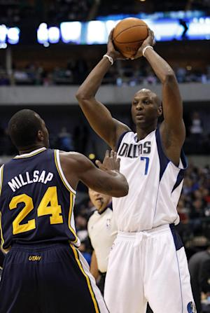 Dallas Mavericks forward Lamar Odom (7) looks to pass against Utah Jazz's Paul Millsap (24) during the first half of an NBA basketball game in Dallas, Saturday, March 3, 2012. (AP Photo/LM Otero)