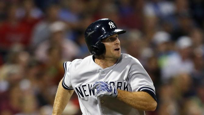 New York Yankees' Brett Gardner watches his three-run triple in the sixth inning of a baseball game against the Boston Red Sox in Boston, Sunday, Aug. 18, 2013. (AP Photo/Michael Dwyer)