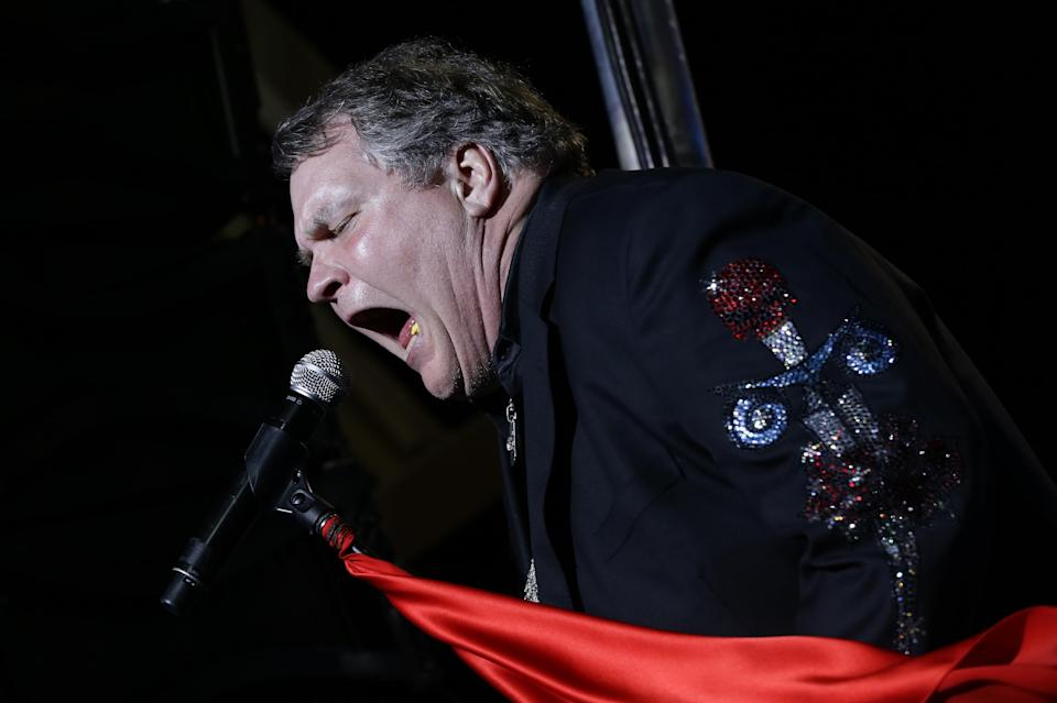 Singer Meat Loaf performs in support of Republican presidential candidate and former Massachusetts Gov. Mitt Romney at the football stadium at Defiance High School in Defiance, Ohio, Thursday, Oct. 25, 2012. (AP Photo/Charles Dharapak)