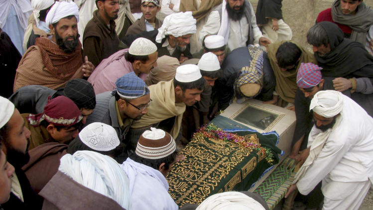 FILE -  In this Dec. 29, 2010, file photo, Pakistani villagers carry the shrouded casket of a person reportedly killed by a US drone attack in Pakistani tribal area of Mir Ali along the Afghanistan border, during his funeral in Bannu, Pakistan. The American ambassador to Islamabad phoned Washington with an urgent plea: Stop an imminent CIA drone strike against militants on the Pakistani side of the Afghan border. (AP Photo/Ijaz Muhammad, file)