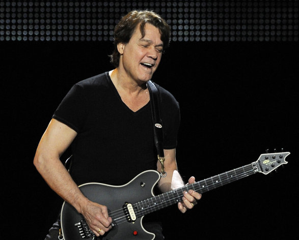 FILE - This June 1, 2012 file photo shows guitarist Eddie Van Halen of the band Van Halen performing in Los Angeles. Van Halen underwent an emergency surgery for the digestive disease diverticulitis and is canceling his tour in Japan to recover. His representative said Thursday, Aug. 30, that Van Halen had a severe bout of diverticulitis and is expected to recover in four to six months. Diverticulitis is a painful condition that involves the formation of pouches on the outside of the colon. (Photo by Chris Pizzello/Invision/AP, file)