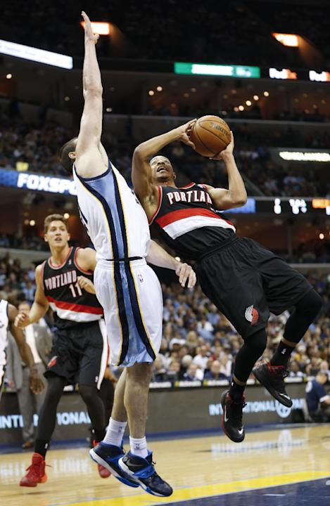 Portland Trail Blazers guard C. J. McCollum, right, shoots around Memphis Grizzlies center Kosta Koufos in the first half of an NBA basketball game on Tuesday, March 11, 2014, in Memphis, Tenn