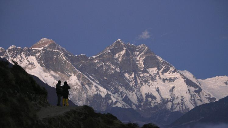 File photograph of travellers enjoying a view of Mount Everest at Syangboche in Nepal