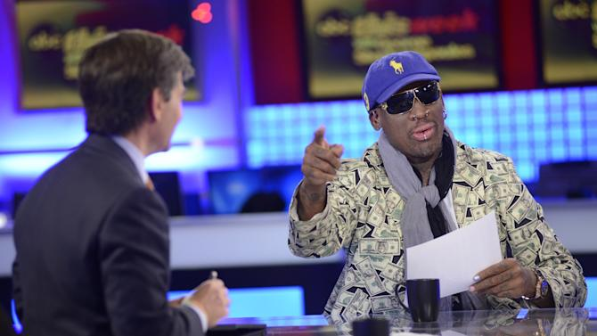 """In this Sunday March 3, 2013, photo provided by ABC television """"This Week"""" host George Stephanopoulos, left, interviews former NBA star Dennis Rodman, just back from a visit with North Korea's young leader Kim Jong Un, in a studio in New York.  (AP Photo/ABC Television, Lorenzo Bevilacqua)"""