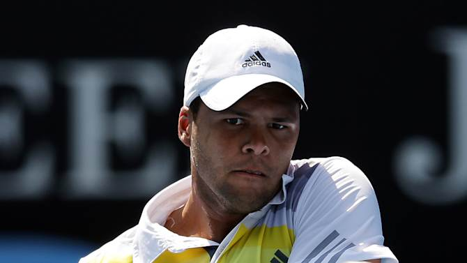 France's Jo-Wilfried Tsonga hits a return to compatriot Richard Gasquet during their fourth round match at the Australian Open tennis championship in Melbourne, Australia, Monday, Jan. 21, 2013.(AP Photo/Aaron Favila)