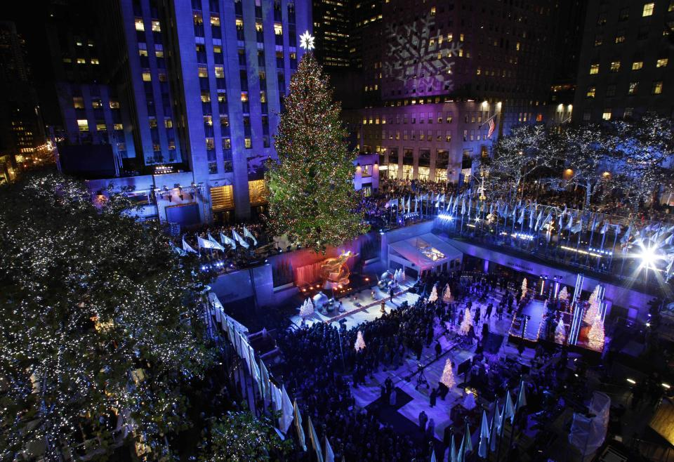 Crowds gather as the Rockefeller Center Christmas Tree is lit during the 80th annual tree lighting ceremony at Rockefeller Center in New York, Wednesday, Nov. 28, 2012. (AP Photo/Kathy Willens)