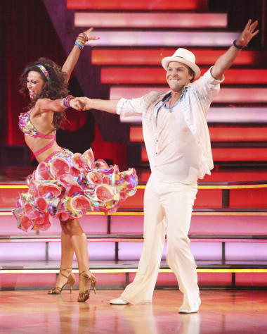 "In this April 16, 2012 photo released by ABC, singer Gavin DeGraw, right, and his partner Karina Smirnoff perform on the celebrity dance competition series, ""Dancing with the Stars,"" in Los Angeles. (AP Photo/ABC, Adam Taylor)"