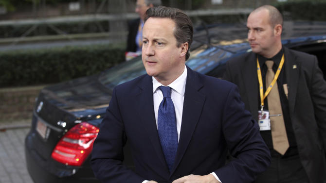 British Prime Minister David Cameron, left, arrives for an EU summit at the EU Council building in Brussels on Thursday, Nov. 22, 2012. EU leaders begin what is expected to be a marathon summit on the budget for the years 2014-2020. The meeting could last through Saturday and break up with no result and lots of finger-pointing. (AP Photo/Yves Logghe)