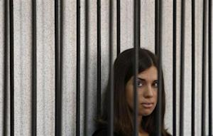 "Member of the female punk band ""Pussy Riot"" Tolokonnikova looks out from a holding cell as she attends a court hearing to appeal for parole at the Supreme Court of Mordovia in Saransk"