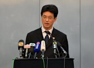 Chengdu People's Intermediate court spokesman Yang Yuquan delivers the verdict of the ex-police chief Wang Lijun to the press in Chengdu, in southwest China's Sichuan province, on September 24. Wang, who triggered a scandal that shocked the Communist Party, was sentenced to 15 years in prison for 'defection and other crimes.'