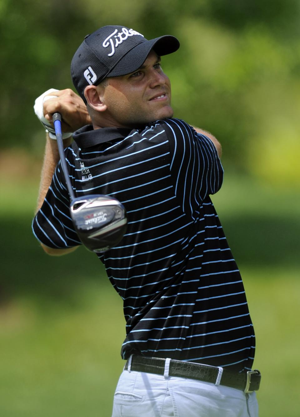 Bill Haas watches his drive from the 11th tee during the third round of the AT&T National golf tournament at Congressional Country Club, Saturday, June 29, 2013, in Bethesda, Md. (AP Photo/Nick Wass)