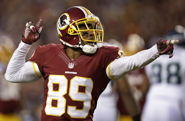 Washington Redskins wide receiver Santana Moss celebrates a play during the first half of an NFL wild card playoff football game against the Seattle Seahawks in Landover, Md., Sunday, Jan. 6, 2013. (A