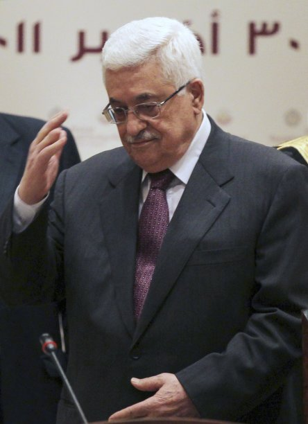 Palestinian President Mahmoud Abbas arrives at the Arab Peace Initiative Committee meeting in Doha