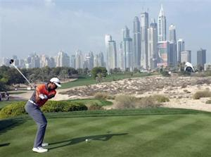 Woods of the U.S.takes a shot on the 8th tee during the third round of the 2014 Omega Dubai Desert Classic in Dubai