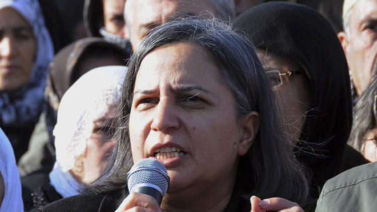 "Kurdish lawmaker Gultan Kisanak addresses several hundreds Turkish Kurds gathered to protest the killings of three Kurdish women, in the southeastern Turkish city of Diyarbakir, Turkey, Thursday, Jan. 10, 2013. The three women were ""executed"" at a Kurdish center in Paris, French Interior minister Manuel Valls said Thursday. (AP Photo)"
