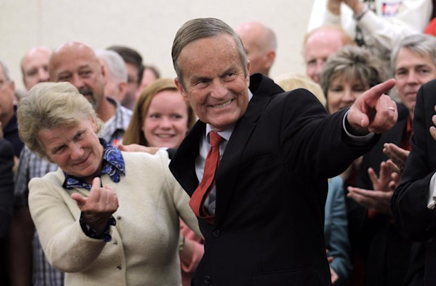 Missouri Republican Senate candidate Rep. Todd Akin, R-Mo., and his wife Lulli Akin, left, take part in a news conference at the start of a statewide bus tour, Tuesday, Sept. 25, 2012, in St. Louis. Akin is hoping that donors displeased by his much-criticized remarks about rape will reopen their checkbooks. (AP Photo/Jeff Roberson)