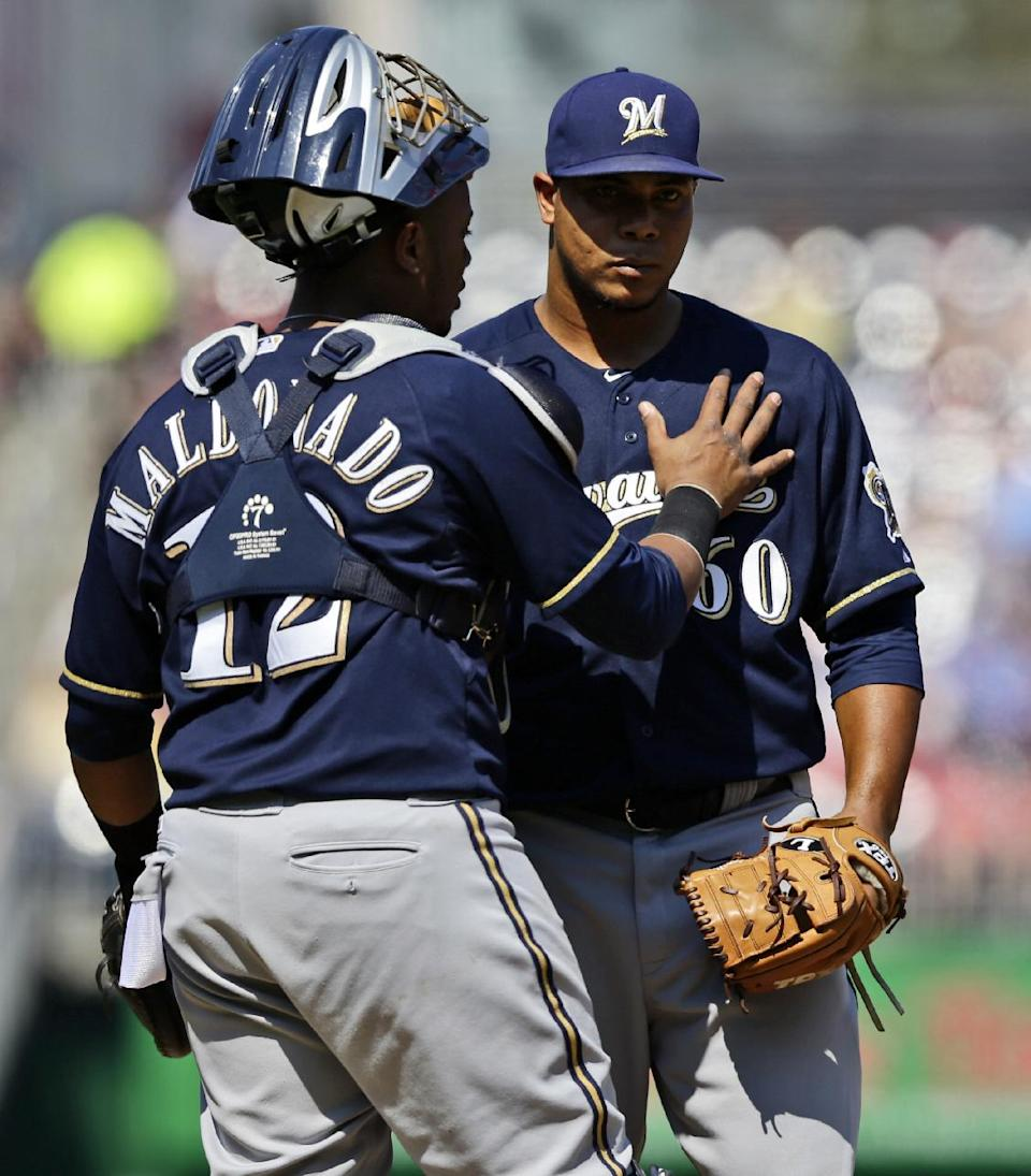 Milwaukee Brewers catcher Martin Maldonado, left, talks with starting pitcher Wily Peralta on the mound during the second inning of a baseball game at Nationals Park Saturday, Sept. 22, 2012, in Washington. (AP Photo/Alex Brandon)
