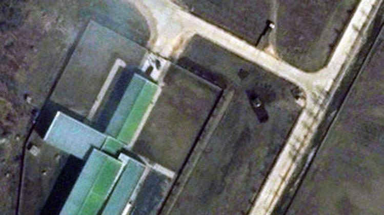 "This March 28, 2012 satellite image provided by DigitalGlobe shows a parked trailer and dish antenna, top right,  near the assembly building at North Korea's Tongchang-ri Launch Facility, on the nation's northwest coast. An analysis of images provided to The Associated Press by the U.S.-Korea Institute at Johns Hopkins School of Advanced International Studies shows Pyongyang ""has undertaken more extensive preparations for its planned April rocket launch than previously understood.""   (AP Photo/DigitalGlobe) MANDATORY CREDIT, NO SALES"