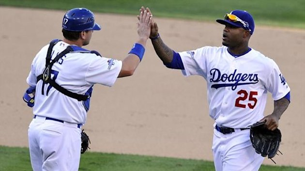 Los Angeles Dodgers left fielder Carl Crawford (25) and catcher A.J. Ellis (17) celebrate (Reuters)
