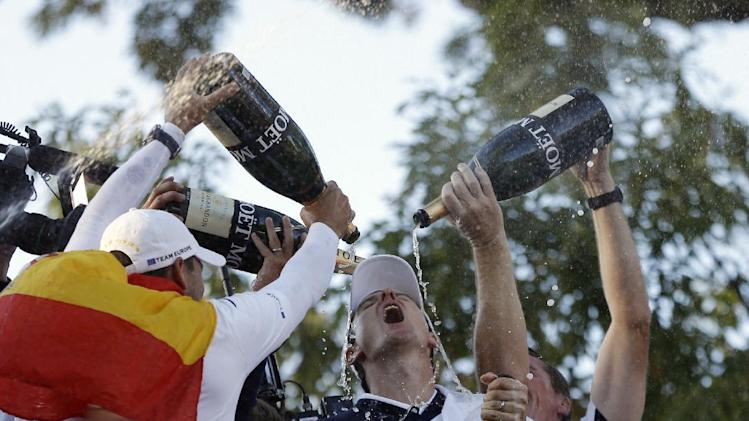 Players pour Champagne on Europe's Justin Rose as the celebrate after winning the Ryder Cup PGA golf tournament Sunday, Sept. 30, 2012, at the Medinah Country Club in Medinah, Ill. (AP Photo/Chris Carlson)